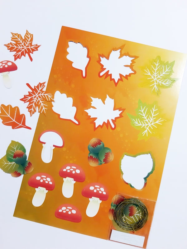 Ausgestanzte Blätter und Pilze