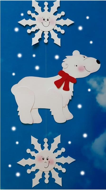 Eine Dekokette mit Eisbär und Schneeflocken zur Winterzeit.