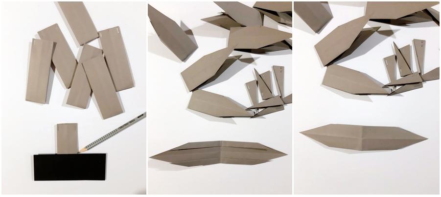 Sternspitzen werden aus Papier gefaltet.