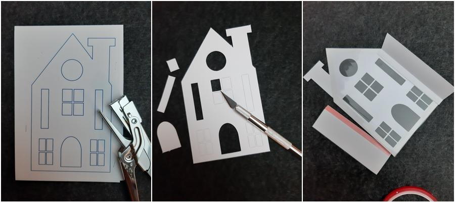 Häuser werden aus Papier ausgeschnitten.