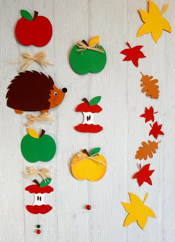 Dekoketten aus Papier mit Igel, Blätter und Äpfeln.