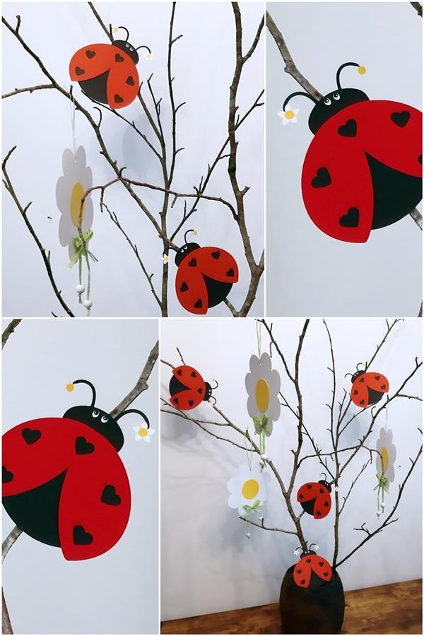 Marienkäfer und Blumen am Zweig