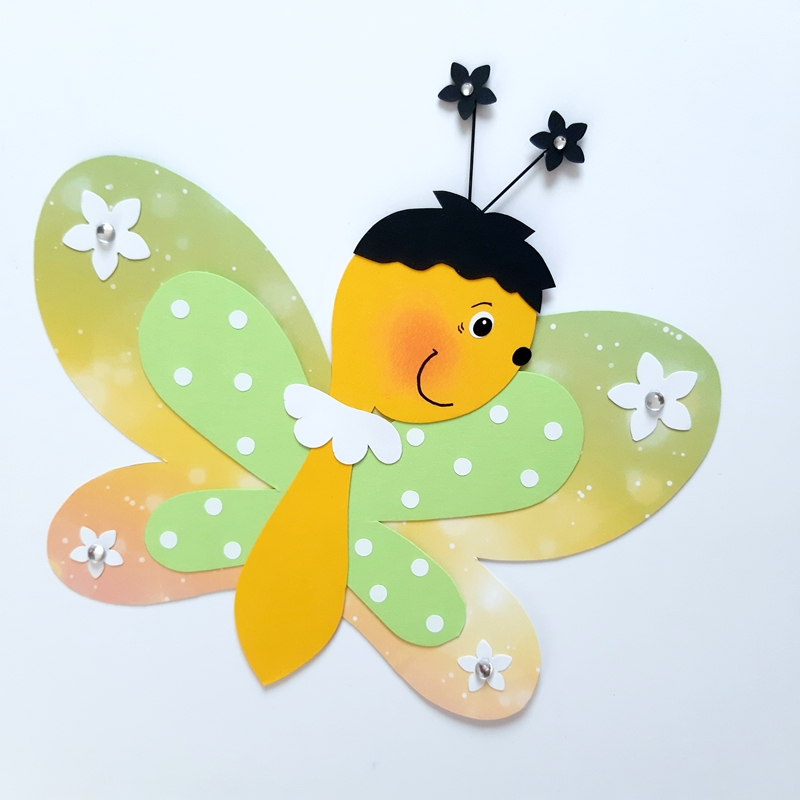Ein gelber Schmetterling aus Papier