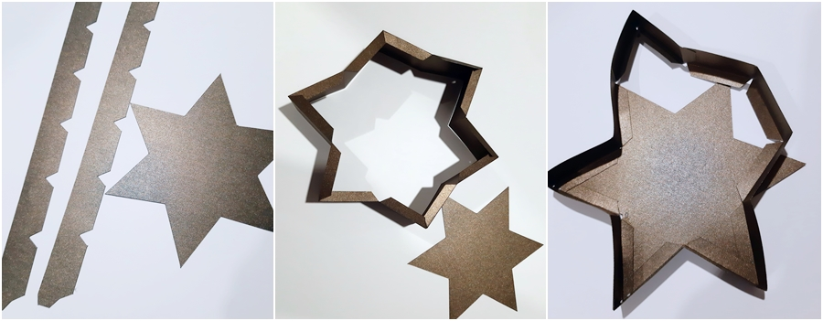 Der Deckel einer Schachtel in Sternform wird zusammengeklebt.